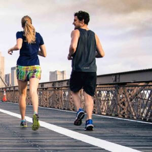 2 people running and exercising for better general and eye health.