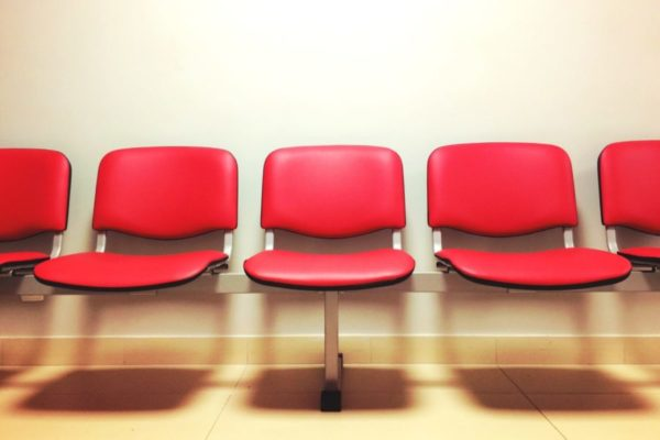 Row of empty seats in waiting room