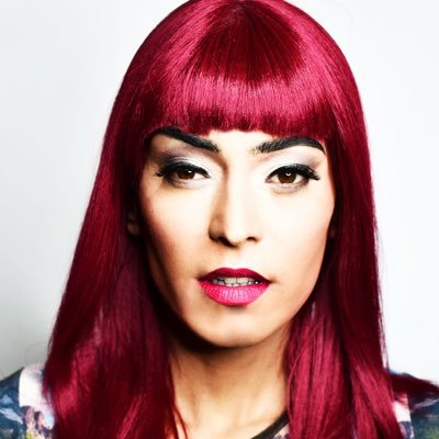 Head shot of lady with bright pink hair